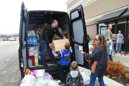 Ken Buckman and family uploading supplies in Washington, Ill.