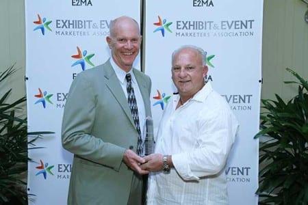 Jim Wurm presents Bernie Massett of MC2 with Intrepid Award Photo credit: Deja Views USA