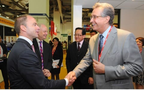 Christian Göke, CEO, Messe Berlin GmbH, and Mike Lee, vice president of sales, Marina Bay Sands, on a VIP Guided Tour at ITB Asia 2014.
