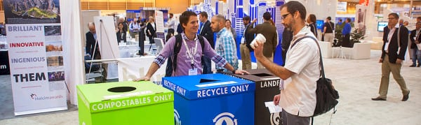 Greenbuild Conference and Expo attendees separate their waste into recycling bins provided by the New Orleans Ernest N. Morial Convention Center.