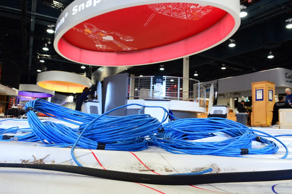 Bundles of CAT 5 Ethernet cable are pre-staged for deployment inside a vendor booth at CES by Cox Business installation technicians.