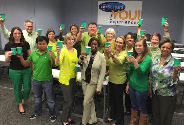 "Shepard Expo team members ""Raising a Cup to Raise Awareness""/"