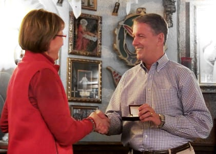 Rosemary Dingmann was awarded a congratulatory ring from Kent Dunham, national sales director.