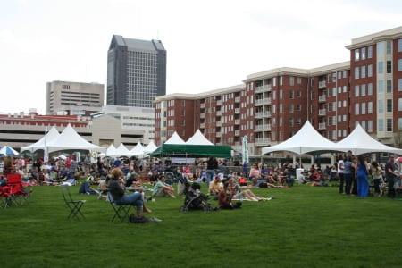 "Locals gather for ""Green Columbus Earth Day"" at outdoor events space."