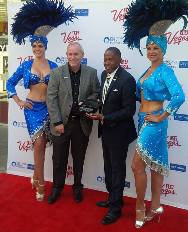 Lawrence Weekly, chairman of the LVCVA Board of Directors (right), presented a key to the Las Vegas Strip to Chris Brown, executive vice president of conventions and business operations of National Association of Broadcasters (left).