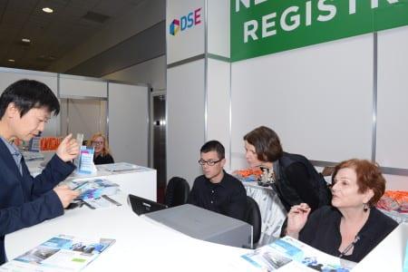 Jane Wedin provides assistance at registration.