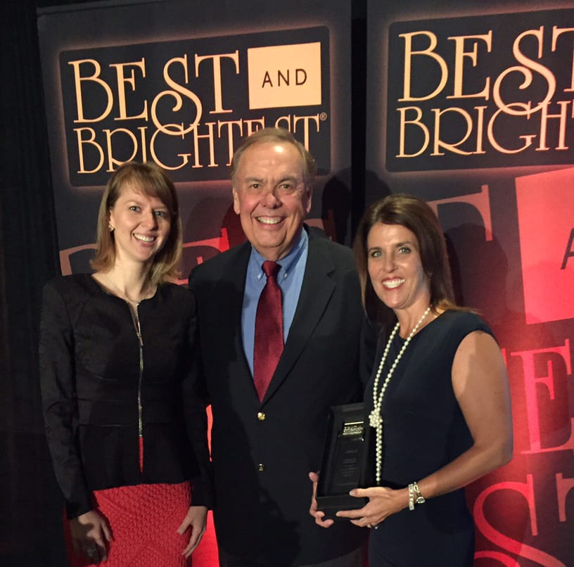 Deb Venable, Nimlok Chicago President (right) and Julia Poroshkova, Nimlok Chicago Marketing Manager (left) with event emcee Pat Cassidy (center) at the Chicago's Best and Brightest Companies to Work For Symposium and Gala Photo Credit: Nimlok Chicago