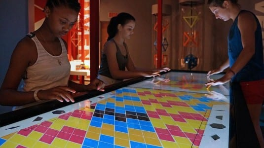 Two interactive multi-touch tabletop activities with a traveling exhibit received Awards of Distinction
