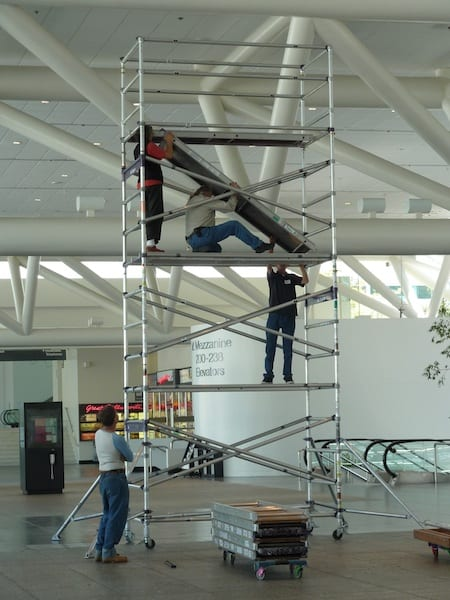 Local 510 Sign and Display working on a scaffold.