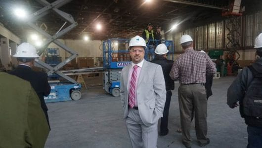 albany-capital-center-general-manager-doug-mcclaine-directing-tour-in-multipurpose-ballroom